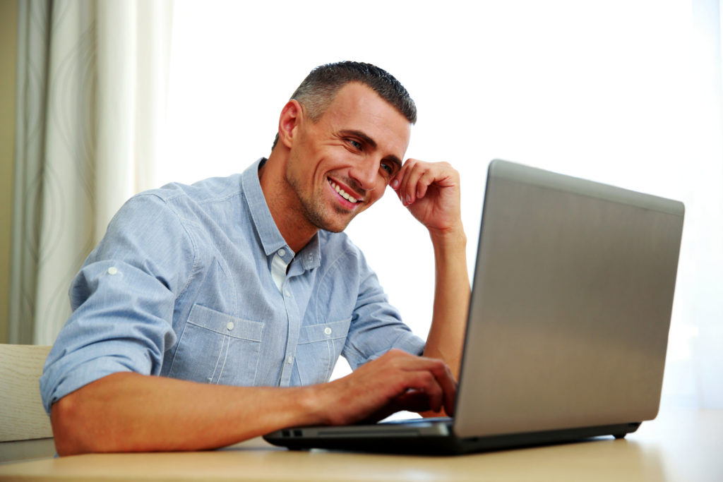 29631345 - smiling businessman working with laptop